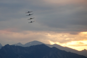 Red Star plane formation in mountain sunset sky