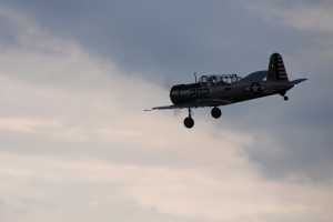 Propellor plane flying at sunset