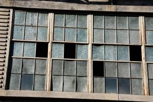 Broken windows of an abandoned building