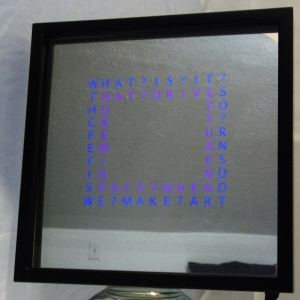 text patterns floating on a two-way framed mirror