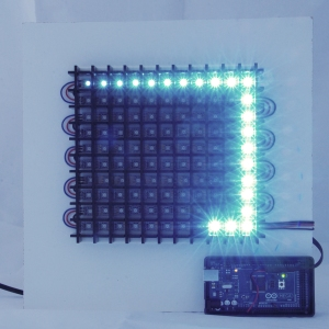 a path of blue-white LEDs around the perimeter of the black acrylic grid