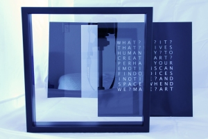 shadow box frame, two-way mirror, vinyl-cut letters on plexiglas, foam core spacer and white acrylic panel