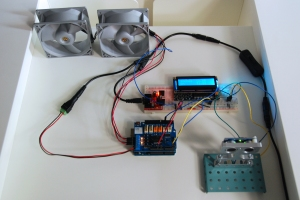 ultrasonic sensor is connected to an arduino, an RGB LCD, an Arduino motor shield, and two brushless fans