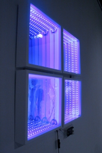 Four frames are lit with LEDS and have mirrors that make one row of lights look like thirty rows