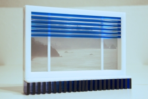 An acrylic frame resembles a window with blue acrylic rods acting as blinds.