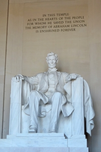 Lincoln Memorial photo of Lincoln seated beneath one of his quotes