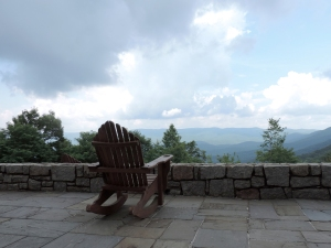 rocking chair on a stone deck